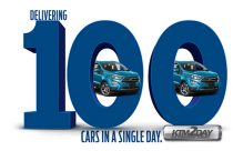 Ford delivers 100 cars to customers